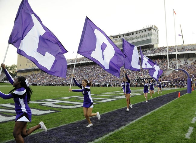 Sep 7, 2013; Evanston, IL, USA;  Northwestern Wildcats cheerleaders after a Northwestern Wildcats scoring play against the Syracuse Orange during the first quarter at Ryan Field. Mandatory Credit: David Banks-USA TODAY Sports