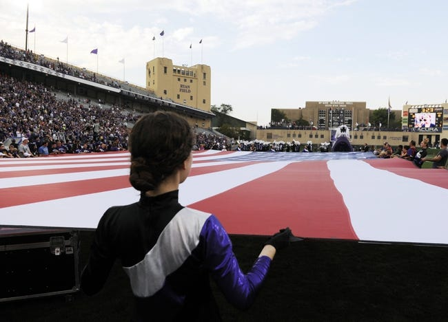 Sep 7, 2013; Evanston, IL, USA; People hold the flag during the national anthem before the game between the Northwestern Wildcats and the Syracuse Orange at Ryan Field. Mandatory Credit: David Banks-USA TODAY Sports