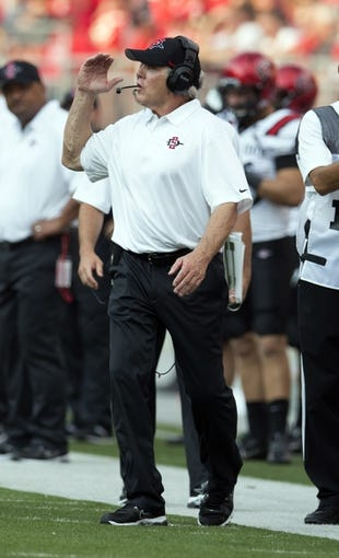 Sep 7, 2013; Columbus, OH, USA; San Diego State Aztecs head coach Rocky Long directs his offense against the Ohio State Buckeyes at Ohio Stadium. Ohio State won the game 42-7. Mandatory Credit: Greg Bartram-USA TODAY Sports