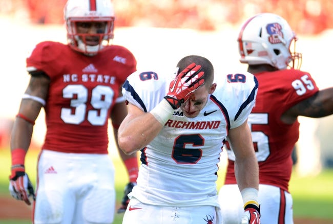 Sep 7, 2013; Raleigh, NC, USA; Richmond Spiders receiver Ben Edwards (6) holds his head after a reception against the North Carolina State Wolfpack at Carter Finley Stadium. Mandatory Credit: Rob Kinnan-USA TODAY Sports