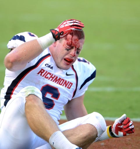 Sep 7, 2013; Raleigh, NC, USA; Richmond Spiders receiver Ben Edwards (6) after losing his helmet and being tackled against the North Carolina State Wolfpack at Carter Finley Stadium. Mandatory Credit: Rob Kinnan-USA TODAY Sports