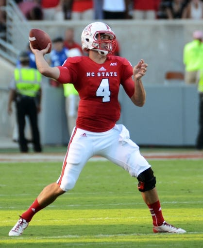 Sep 7, 2013; Raleigh, NC, USA; North Carolina State Wolfpack quarterback Pete Thomas (4) throws a pass against the Richmond Spiders at Carter Finley Stadium. Mandatory Credit: Rob Kinnan-USA TODAY Sports