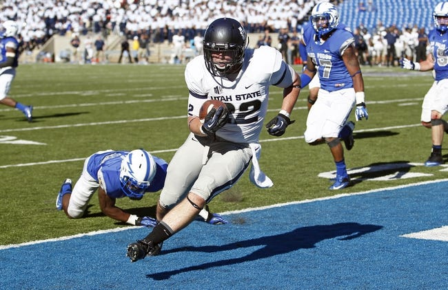 Sep 7, 2013; Colorado Springs, CO, USA; Utah State Aggies tight end Keegan Andersen (22) scores a touchdown in the fourth quarter against the Air Force Falcons at Falcon Stadium. The Aggies won 52-20. Mandatory Credit: Isaiah J. Downing-USA TODAY Sports