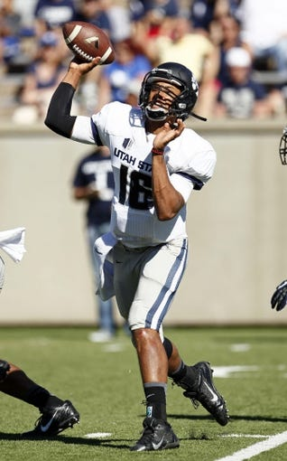 Sep 7, 2013; Colorado Springs, CO, USA; Utah State Aggies quarterback Chuckie Keeton (16) throws the ball in the third quarter against the Air Force Falcons at Falcon Stadium. The Aggies won 52-20. Mandatory Credit: Isaiah J. Downing-USA TODAY Sports