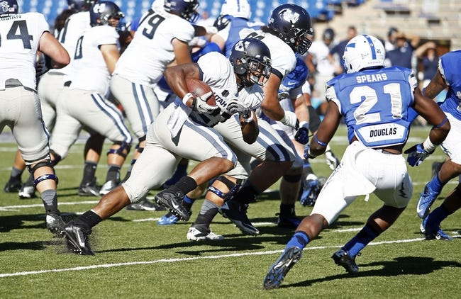 Sep 7, 2013; Colorado Springs, CO, USA; Utah State Aggies running back Robert Marshall (27) runs the ball against Air Force Falcons defensive back Christian Spears (21) in the fourth quarter at Falcon Stadium. The Aggies won 52-20. Mandatory Credit: Isaiah J. Downing-USA TODAY Sports