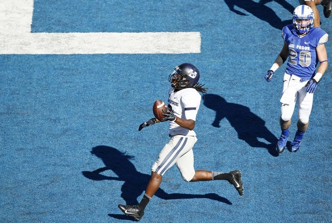 Sep 7, 2013; Colorado Springs, CO, USA; Air Force Falcons defensive back Gavin McHenry (20) watches as Utah State Aggies wide receiver Travis Reynolds (8) scores a touchdown in the third quarter at Falcon Stadium. The Aggies won 52-20. Mandatory Credit: Isaiah J. Downing-USA TODAY Sports