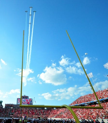 Sep 7, 2013; Raleigh, NC, USA; planes perform a flyover prior to a game between the North Carolina State Wolfpack and Richmond Spiders at Carter Finley Stadium. Mandatory Credit: Rob Kinnan-USA TODAY Sports