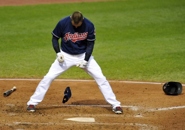 Sep 7, 2013; Cleveland, OH, USA; Cleveland Indians first baseman Nick Swisher (33) reacts after striking out in the fourth inning against the New York Mets at Progressive Field. Mandatory Credit: David Richard-USA TODAY Sports