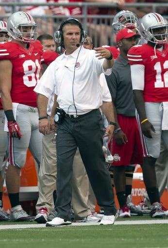 Sep 7, 2013; Columbus, OH, USA; Ohio State Buckeyes head coach Urban Meyer directs his players onfield during the game against the San Diego State Aztecs at Ohio Stadium. Ohio State won the game 42-7. Mandatory Credit: Greg Bartram-USA TODAY Sports