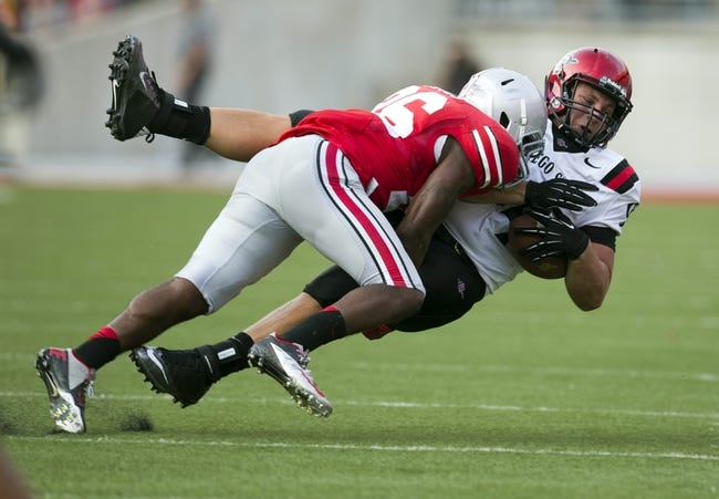 Sep 7, 2013; Columbus, OH, USA; San Diego State Aztecs tight end Robert Craighead (94) is tackled by Ohio State Buckeyes cornerback Armani Reeves (26) at Ohio Stadium. Ohio State won the game 42-7. Mandatory Credit: Greg Bartram-USA TODAY Sports
