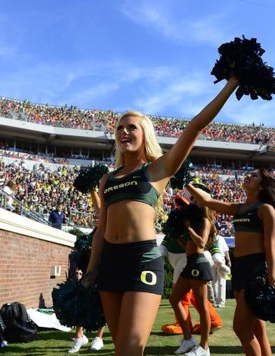 Sep 7, 2013; Charlottesville, VA, USA; Oregon Ducks cheerleader reacts on the sidelines. The Ducks defeated the Virginia Cavaliers 59-10 at Scott Stadium. Mandatory Credit: Bob Donnan-USA TODAY Sports
