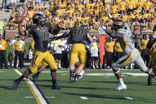 Sep 7, 2013; Columbia, MO, USA;  Missouri Tigers quarterback James Franklin (1) attempts to pass during the second half against the Toledo Rockets. Missouri defeats Toledo 38-23 at Faurot Field . Mandatory Credit: Jasen Vinlove-USA TODAY Sports