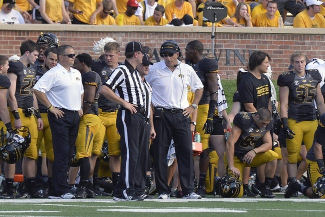 Sep 7, 2013; Columbia, MO, USA;  Missouri Tigers head coach Gary Pinkel discusses a play with a referee during the second half against the Toledo Rockets. Missouri defeats Toledo 38-23 at Faurot Field . Mandatory Credit: Jasen Vinlove-USA TODAY Sports