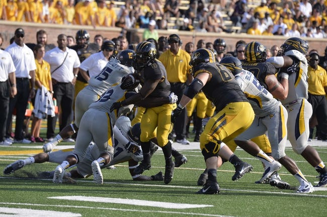 Sep 7, 2013; Columbia, MO, USA;  Missouri Tigers running back Marcus Murphy (6) is tackled by Toledo Rockets defensive back Junior Sylvestre (33) during the second half. Missouri defeats Toledo 38-23 at Faurot Field . Mandatory Credit: Jasen Vinlove-USA TODAY Sports