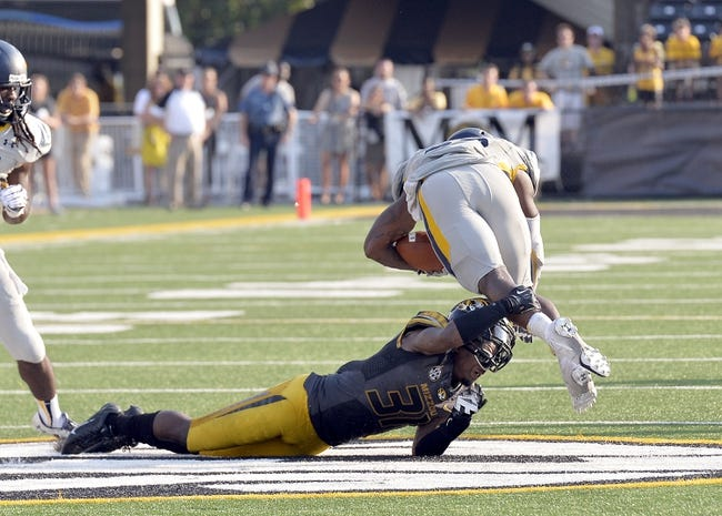 Sep 7, 2013; Columbia, MO, USA; Toledo Rockets running back David Fluellen (22) is tackled by Missouri Tigers defensive back E.J. Gaines (31) during the second half. Missouri defeats Toledo 38-23 at Faurot Field . Mandatory Credit: Jasen Vinlove-USA TODAY Sports