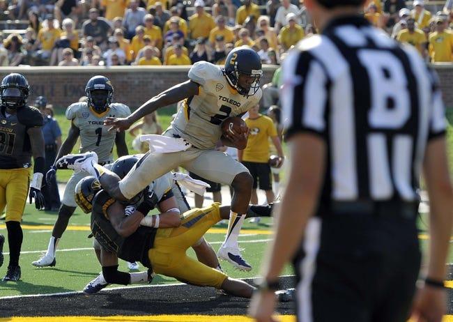 Sep 7, 2013; Columbia, MO, USA;  Toledo Rockets quarterback Terrance Owens (2) scores a touchdown during the second half. Missouri defeats Toledo 38-23 at Faurot Field . Mandatory Credit: Jasen Vinlove-USA TODAY Sports