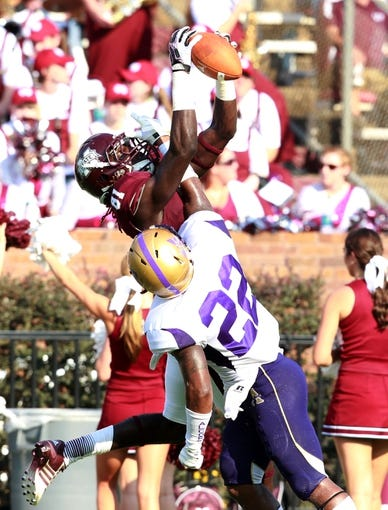 Sep 7, 2013; Starkville, MS, USA;  Mississippi State Bulldogs wide receiver De'Runnya Wilson (81) goes up for the ball along with Alcorn State Braves defensive back Jamison Knox (22) at Davis Wade Stadium.  The Bulldogs defeated the Braves 51-7. Mandatory Credit: Marvin Gentry-USA TODAY Sports