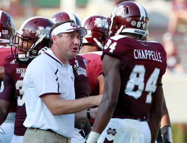 Sep 7, 2013; Starkville, MS, USA;  Mississippi State Bulldogs head coach Dan Mullen talks to wide receiver Jeremey Chappell (84) during the game against the Alcorn State Braves at Davis Wade Stadium.  The Bulldogs defeated the Braves 51-7. Mandatory Credit: Marvin Gentry-USA TODAY Sports