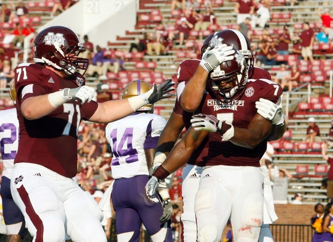 Sep 7, 2013; Starkville, MS, USA;  Mississippi State Bulldogs running back Nick Griffin (7) celebrates with teammates after scoring a touchdown against the Alcorn State Braves at Davis Wade Stadium.  The Bulldogs defeated the Braves 51-7. Mandatory Credit: Marvin Gentry-USA TODAY Sports