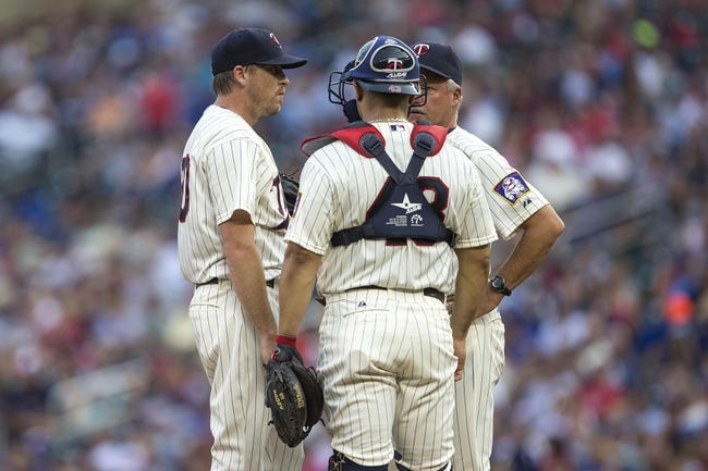 Sep 7, 2013; Minneapolis, MN, USA; Minnesota Twins starting pitcher Kevin Correia (30), and catcher Josmil Pinto (43) talk with pitching coach Rick Anderson in the first inning against the Toronto Blue Jays at Target Field. Mandatory Credit: Jesse Johnson-USA TODAY Sports