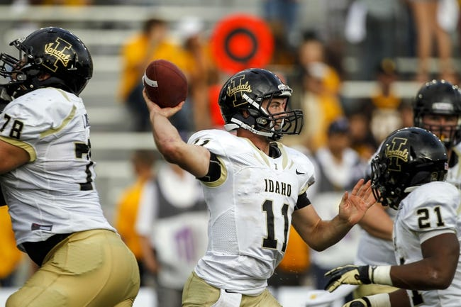 Sep 7, 2013; Laramie, WY, USA; Idaho Vandals quarterback Chad Chalich (11) rolls out to throw against the Wyoming Cowboys during the fourth quarter at War Memorial Stadium. The Cowboys defeated the Vandals 42-10. Mandatory Credit: Troy Babbitt-USA TODAY Sports