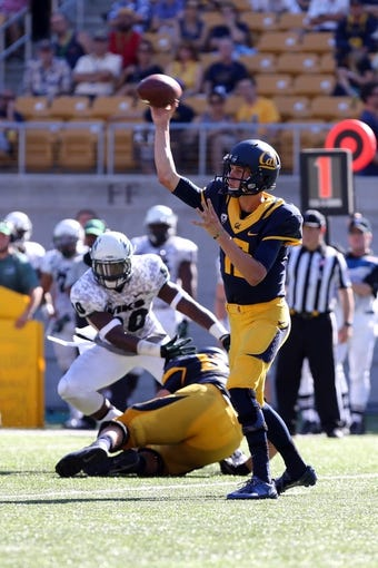 Sep 7, 2013; Berkeley, CA, USA; California Golden Bears quarterback Jared Goff (16) passes the ball against the Portland State Vikings during the third quarter at Memorial Stadium. Mandatory Credit: Kelley L Cox-USA TODAY Sports