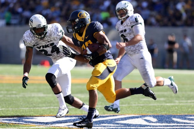 Sep 7, 2013; Berkeley, CA, USA; California Golden Bears running back Khalfani Muhammad (29) carries the ball against Portland State Vikings cornerback Dennis Fite (24) and linebacker Jaycob Shoemaker (6) during the third quarter at Memorial Stadium. Mandatory Credit: Kelley L Cox-USA TODAY Sports