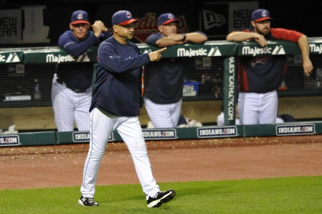 Sep 7, 2013; Cleveland, OH, USA; Cleveland Indians manager Terry Francona (17) makes a pitching change in the sixth inning against the New York Mets at Progressive Field. Mandatory Credit: David Richard-USA TODAY Sports