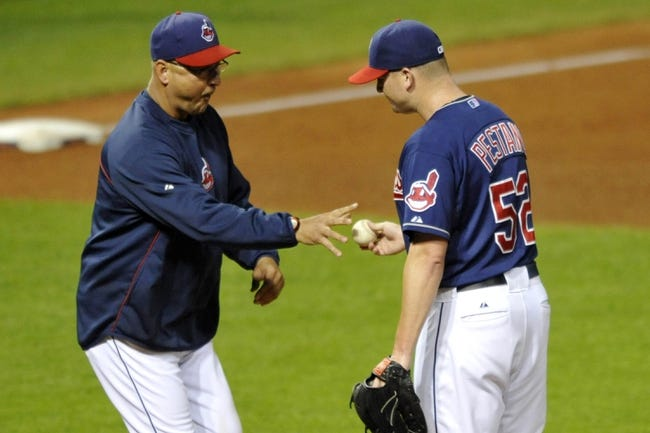 Sep 7, 2013; Cleveland, OH, USA; Cleveland Indians manager Terry Francona (left) takes the ball from relief pitcher Vinnie Pestano (52) during a pitching change in the sixth inning at Progressive Field. Mandatory Credit: David Richard-USA TODAY Sports