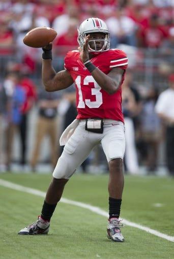 Sep 7, 2013; Columbus, OH, USA;  Ohio State Buckeyes quarterback Kenny Guiton (13) at Ohio Stadium. Ohio State won the game 42-7. Mandatory Credit: Greg Bartram-USA TODAY Sports