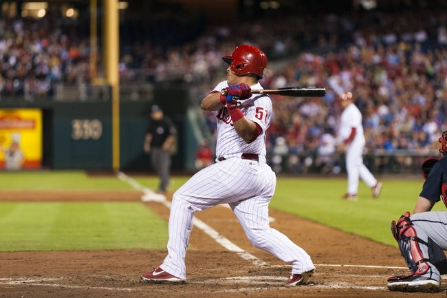 Sep 7, 2013; Philadelphia, PA, USA; Philadelphia Phillies catcher Carlos Ruiz (51) hits a two RBI single during the third inning against the Atlanta Braves at Citizens Bank Park. Mandatory Credit: Howard Smith-USA TODAY Sports
