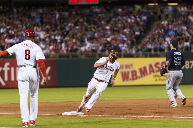 Sep 7, 2013; Philadelphia, PA, USA; Philadelphia Phillies first baseman Kevin Frandsen (28) rounds third base on his way to scoring during the third inning against the Atlanta Braves at Citizens Bank Park. Mandatory Credit: Howard Smith-USA TODAY Sports