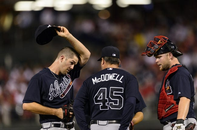Sep 7, 2013; Philadelphia, PA, USA; Atlanta Braves pitching coach Roger McDowell talks with pitcher Alex Wood (58) during the third inning against the Philadelphia Phillies at Citizens Bank Park. Mandatory Credit: Howard Smith-USA TODAY Sports