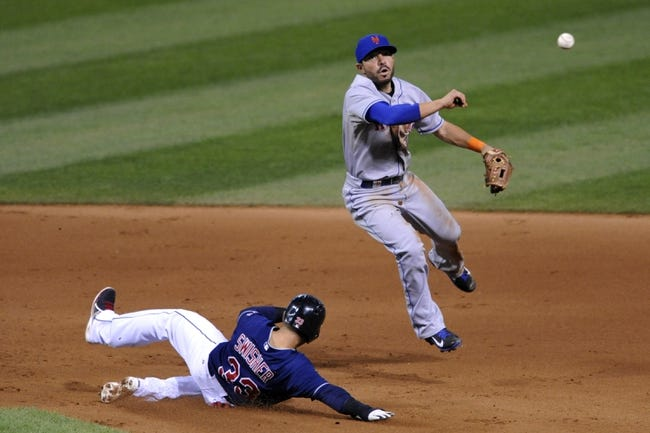 Sep 7, 2013; Cleveland, OH, USA; New York Mets shortstop Omar Quintanilla (3) throws to first base after forcing out Cleveland Indians first baseman Nick Swisher (33) on a fielder's choice in the seventh inning at Progressive Field. Mandatory Credit: David Richard-USA TODAY Sports