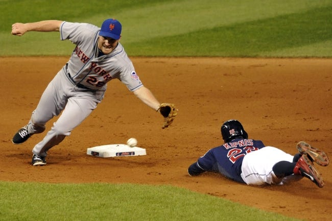 Sep 7, 2013; Cleveland, OH, USA; Cleveland Indians second baseman Jason Kipnis (22) steals second base as New York Mets second baseman Daniel Murphy (28) reaches for the ball in the seventh inning at Progressive Field. Mandatory Credit: David Richard-USA TODAY Sports