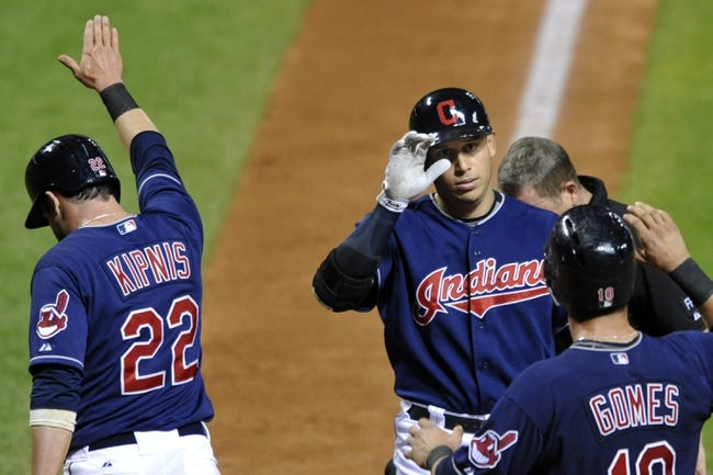 Sep 7, 2013; Cleveland, OH, USA; Cleveland Indians shortstop Asdrubal Cabrera (center) celebrates his three-run home run with second baseman Jason Kipnis (22) and catcher Yan Gomes (10) in the seventh inning against the New York Mets at Progressive Field. Mandatory Credit: David Richard-USA TODAY Sports