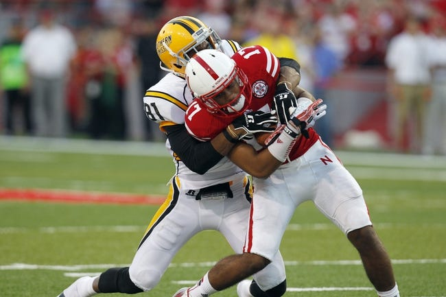 Sep 7, 2013; Lincoln, NE, USA; Southern Mississippi Golden Eagles receiver Rickey Bradley (81) tackles Nebraska Cornhuskers defender Ciante Evans (17) after Evans intercepted the pass in the third quarter at Memorial Stadium. Mandatory Credit: Bruce Thorson-USA TODAY Sports