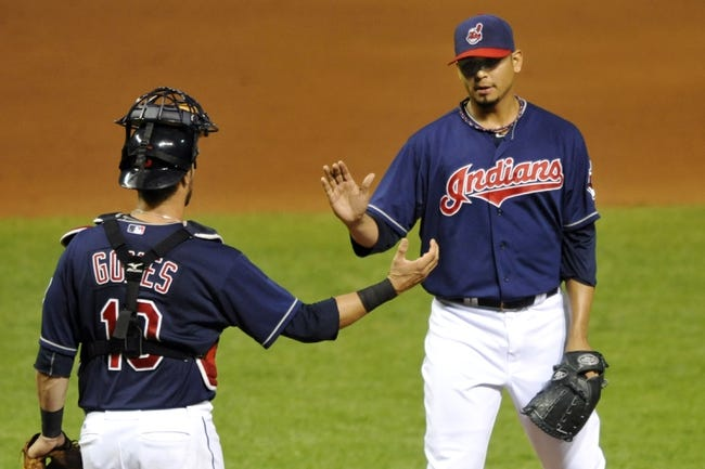 Sep 7, 2013; Cleveland, OH, USA; Cleveland Indians starting pitcher Carlos Carrasco (right) and catcher Yan Gomes (10) celebrate a 9-4 win over the New York Mets at Progressive Field. Mandatory Credit: David Richard-USA TODAY Sports
