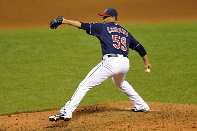 Sep 7, 2013; Cleveland, OH, USA; Cleveland Indians starting pitcher Carlos Carrasco (59) delivers in the ninth inning against the New York Mets at Progressive Field. Mandatory Credit: David Richard-USA TODAY Sports