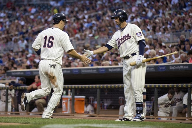 Sep 7, 2013; Minneapolis, MN, USA; Minnesota Twins left fielder Josh Willingham (16) celebrates with first baseman Chris Colabello (55) after scoring a run in the fourth inning at Target Field. Mandatory Credit: Jesse Johnson-USA TODAY Sports