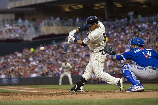 Sep 7, 2013; Minneapolis, MN, USA; Minnesota Twins left fielder Oswaldo Arcia (31) hits a RBI single in the fourth inning against the Toronto Blue Jays at Target Field. Mandatory Credit: Jesse Johnson-USA TODAY Sports