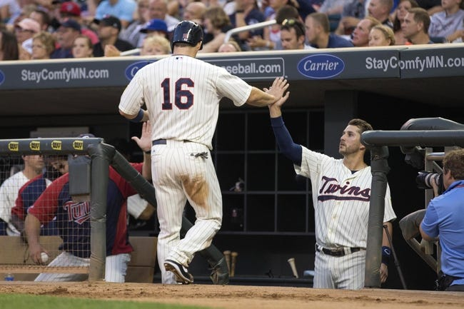 Sep 7, 2013; Minneapolis, MN, USA; Minnesota Twins left fielder Josh Willingham (16) celebrates with third baseman Trevor Plouffe (24) after scoring a run in the fourth inning against the Toronto Blue Jays at Target Field. Mandatory Credit: Jesse Johnson-USA TODAY Sports