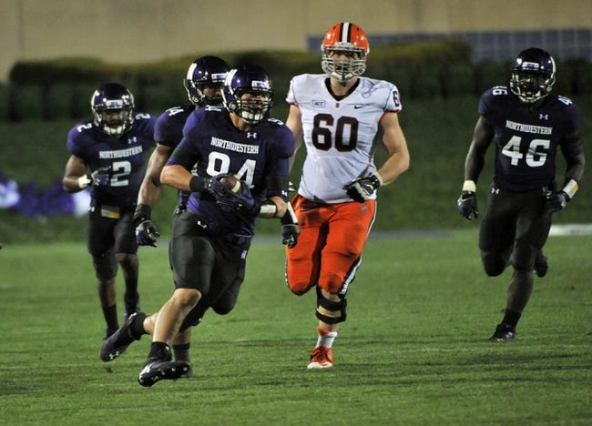 Sep 7, 2013; Evanston, IL, USA; Northwestern Wildcats defensive lineman Dean Lowry (94) intercepts a pass against the Syracuse Orange during the fourth quarter at Ryan Field. Mandatory Credit: David Banks-USA TODAY Sports