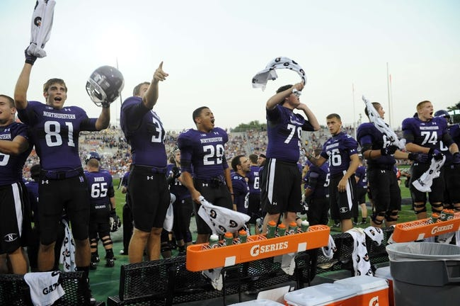 Sep 7, 2013; Evanston, IL, USA;  Northwestern Wildcats players cheer on their team against the Syracuse Orange during the third quarter at Ryan Field. Mandatory Credit: David Banks-USA TODAY Sports