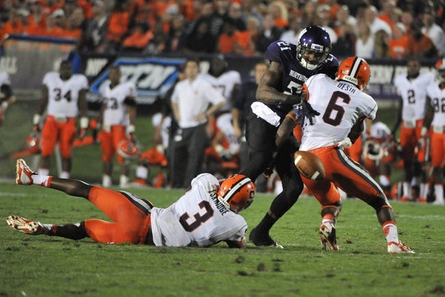 Sep 7, 2013; Evanston, IL, USA;  Northwestern Wildcats wide receiver Kyle Prater (21) is hit by Syracuse Orange safety Ritchy Desir (6) and  safety Durell Eskridge (3) during the fourth quarter at Ryan Field. Mandatory Credit: David Banks-USA TODAY Sports