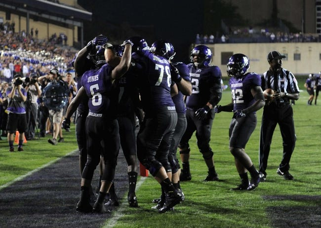 Sep 7, 2013; Evanston, IL, USA; Northwestern Wildcats wide receiver Tony Jones (6)  celebrates with his teammates after catching a touchdown pass against Syracuse Orange  during the fourth quarter at Ryan Field. Mandatory Credit: David Banks-USA TODAY Sports