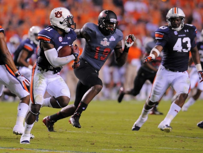 Sep 7, 2013; Auburn, AL, USA; Auburn Tigers tight end Brandon Fulse (11) runs the ball past Arkansas State Red Wolves defensive back Colin Janice (13) at Jordan Hare Stadium. Mandatory Credit: Shanna Lockwood-USA TODAY Sports