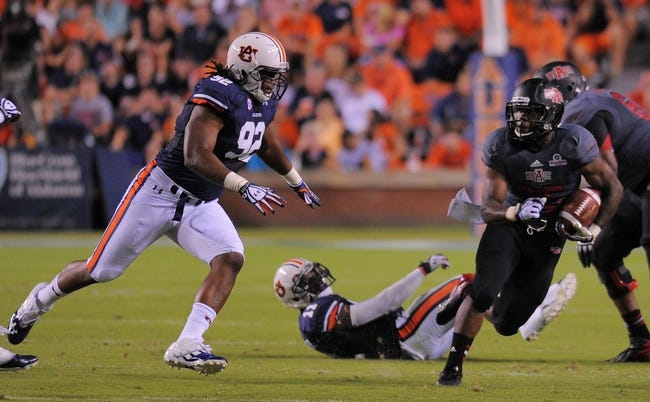 Sep 7, 2013; Auburn, AL, USA; Auburn Tigers defensive end Kenneth Carter (92) tries to keep up with Arkansas State Red Wolves running back David Oku (25) at Jordan Hare Stadium. Mandatory Credit: Shanna Lockwood-USA TODAY Sports