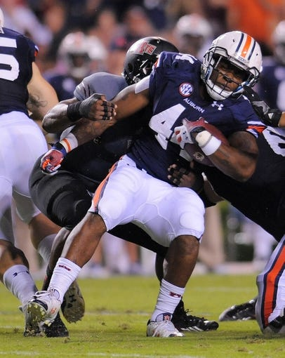Sep 7, 2013; Auburn, AL, USA; Auburn Tigers running back Cameron Artis-Payne (44) is taken down by Arkansas State Red Wolves defense in the first half at Jordan Hare Stadium. Mandatory Credit: Shanna Lockwood-USA TODAY Sports