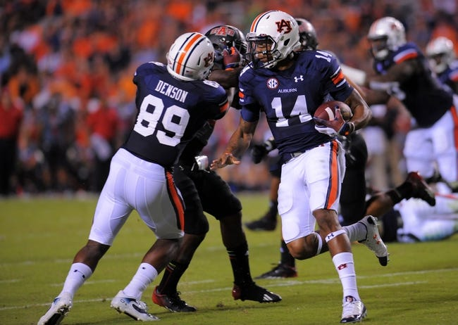 Sep 7, 2013; Auburn, AL, USA; Auburn Tigers quarterback Nick Marshall (14) runs the ball against the Arkansas State Red Wolves at Jordan Hare Stadium. Mandatory Credit: Shanna Lockwood-USA TODAY Sports